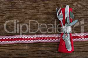 Fork, butter knife, leaf and napkin