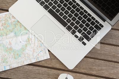 Laptop and world map on wooden plank: Royalty-free images ...