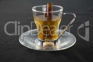 Glass cup of tea with cinnamon