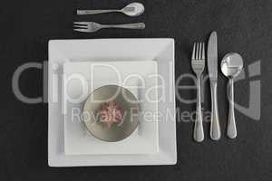Elegant table setting with floral arrangement