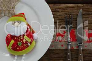 Santa claus with christmas ornament and cutlery