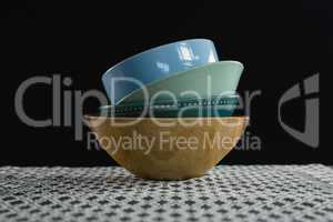 Stack of bowl on table cloth