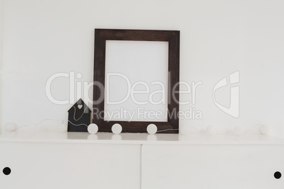 Picture frame with decorations on table