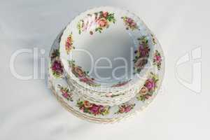 Plates and bowl with floral design set elegantly on a table
