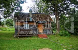 rural wooden house in the summer in Russia