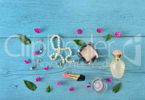 Cosmetics, perfumes and jewelry made of pearls on an old wooden
