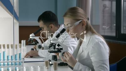 Female researcher conducting an experiment in lab