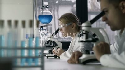 Two scientists working at research laboratoy