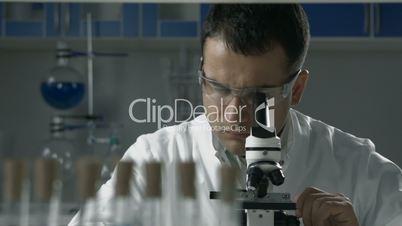 Scientific researcher using microscope in the lab