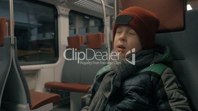 Boy traveling by suburban train