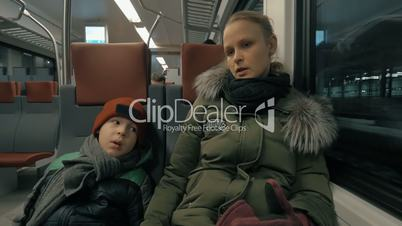 Mother and child having a ride in suburban train