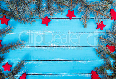 wooden background of parallel boards with green spruce branches