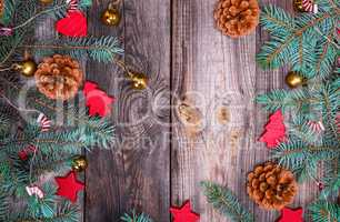 gray wood background with green spruce branches