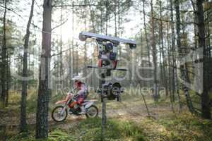 Enduro journey with dirt bike high in the mountains cablecam shooting
