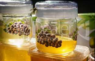 A variety of varieties of honey in jars offered for sale at the
