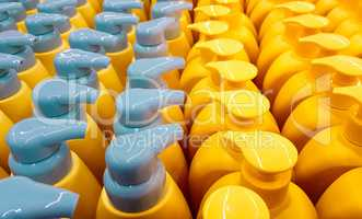Color plastic bottles with lids in a row.