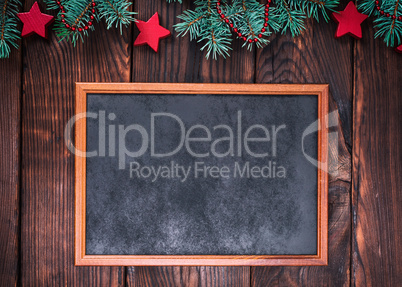 empty wooden frame on a brown background of boards
