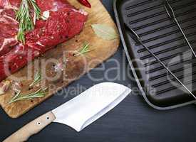 A fresh piece of beef on a kitchen cutting board
