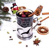mulled wine in a glass on a white wooden background