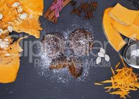 pumpkin muffins sprinkled with powdered sugar