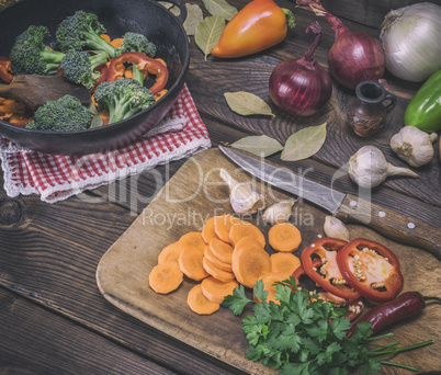 sliced carrots on a wooden kitchen board