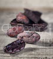 Cocoa beans and piece of dark chocolate