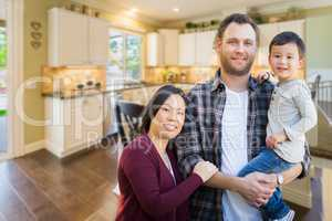 Mixed Race Chinese and Caucasian Parents and Child Indoors Insid