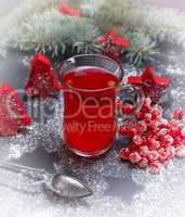 tea made from fresh berries of viburnum in a glass cup