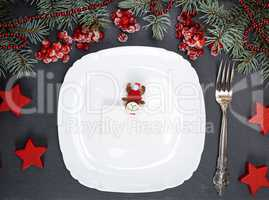 empty white square plate and fork