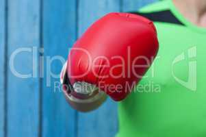 human hand in a red boxing glove