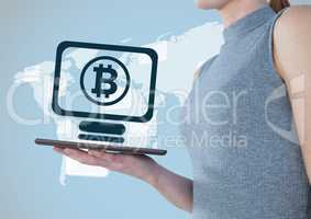 Bitcoin computer icon and woman with tablet