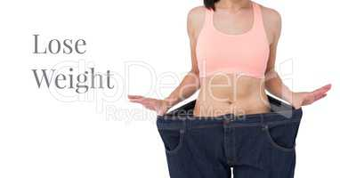 Lose weight text and fit woman wearing oversized trousers