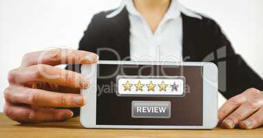 Woman holding phone with review button and star ratings