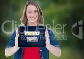 Woman holding tablet with star ratings button