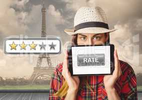 Woman holding tablet with rate button and star reviews over Paris