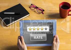 Hands holding tablet with  rate button and star ratings review