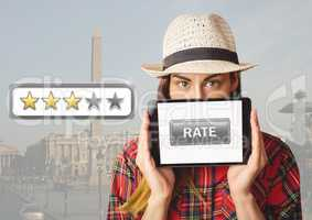 Woman holding tablet with rate button and star reviews over travel destination