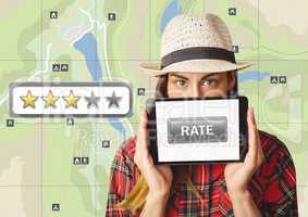 Woman holding tablet with rate button and star reviews over map