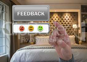Hand pointing at feedback button and smiley faces review in accommodation bedroom