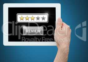 Hands holding tablet with review star ratings