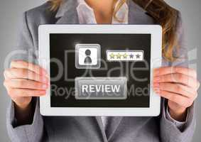 Woman holding tablet with review button and star ratings