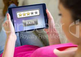 Woman holding tablet with star ratings review button