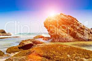 Sunset rocks on beach.