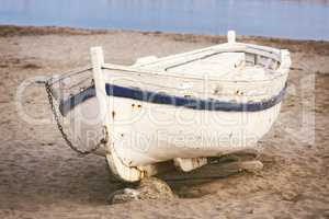 Old boat on the sand
