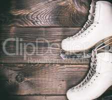 a pair of white leather skates