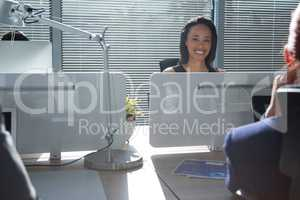 Smiling executive sitting in the office