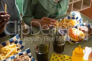 Couple hands having fast food in the restaurant
