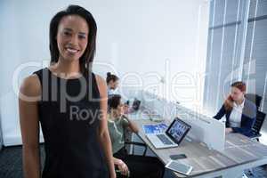 Beautiful female executive looking at camera