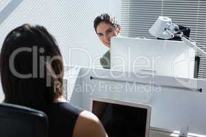 Female executive discussing with each other