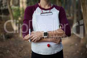 Woman folding hands holding writing pad in her arms